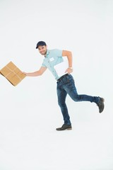 Happy delivery man running with package