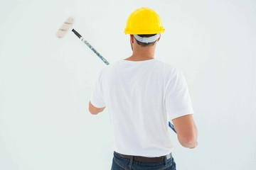 Man using paint roller