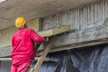 Man installing external wall insulation 2