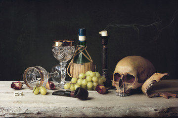 Vanitas witch Skull; Pipe, tobacco, dice; wine glass, wine and g