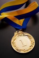 Gold medal on a dark background