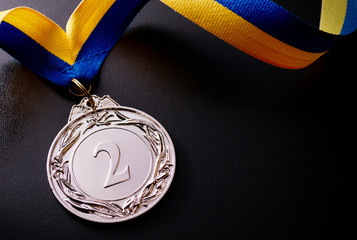 Silver medal on a dark background