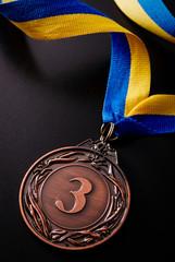 Bronze medal on a dark background