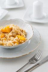 risotto with pumpkin in white bowl