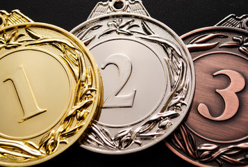 Three medals for prizes