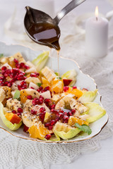fruit and vegetable salad with sauce on white plate