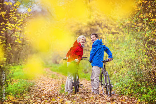 canvas print picture Active seniors walking with bike