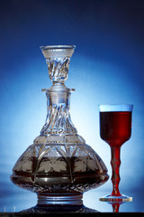 Decanter with wine and glass