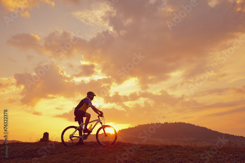 canvas print picture Biker Mountainbike Sonne Wolken