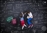 Two schoolkids learning - 76322784