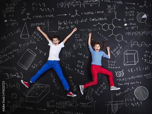 Leinwanddruck Bild Two schoolkids learning