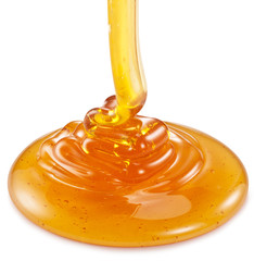 Honey flowing on the white background.