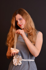 Beautiful sensual woman holding luxury pearls and seashell
