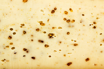 Background of yellow cheese with nuts