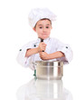 Little confused boy chef with ladle stirring in the pot
