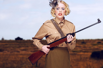 Stylish Girl Scout with Gun at the Field