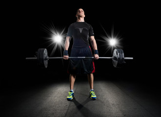 Crossfit athlete performs  weight lift