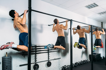 Group of Muscular Men Doing Pull Ups