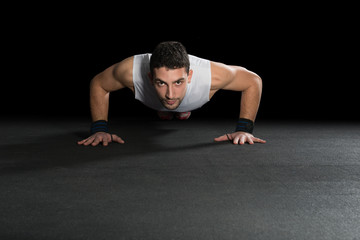 Muscular Men Doing Push-ups as part of Crossfit Training