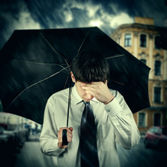 Sad Man under the Rain