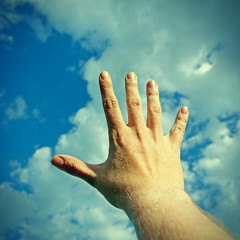 Hand on the Sky Background