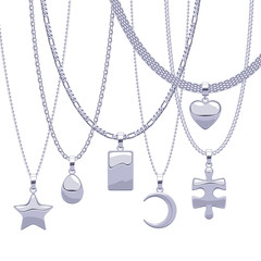 Set of silver chains with different pendants.