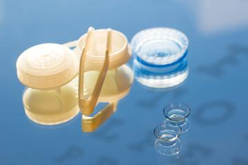 contact lenses, tweezes, Snellen chart, vision correction