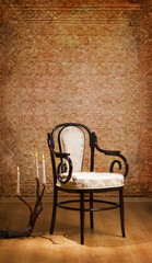 vintage chair and candles in the dark room