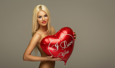 Blond beautiful woman with red balloon