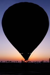 Silhouette of the balloon on sunset