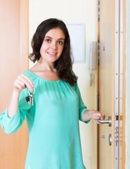 brunette unlocking outer door