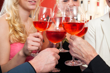Close up Toasting Glasses of Rose Wine.