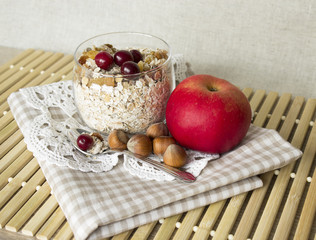 muesli with cranberries, apples and nuts in a glass