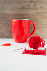 Valentine's day gift box with greeting card and red cup.