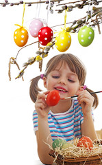 little girl coloring easter eggs
