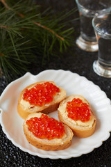 Canape with red caviar and butter