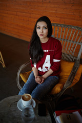 Attractive brunette hair model sitting on coffee shop