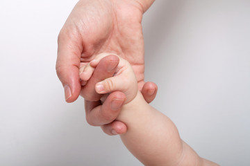 Mommy holding baby's hand