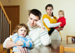 Young couple with children in quarrel