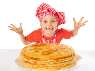 Happy beautiful little girl with pancakes