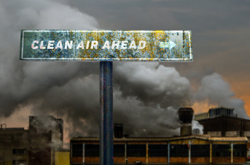 Clean air ahead slogan on the road sign in front of the pollutin