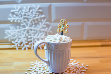 Hot chocolate with marshmallows and cute tea spoon closeup