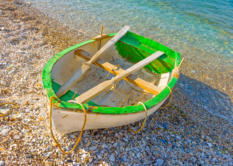 Old fishing boat by the sea in Amorgos island in Greece