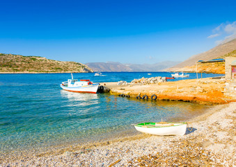Old fishing boats by the sea in Amorgos island in Greece