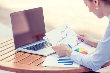 woman investment consultant analyzing company financial report
