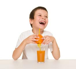 little boy with orange juice