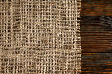 Texture of burlap bordered with old wood background