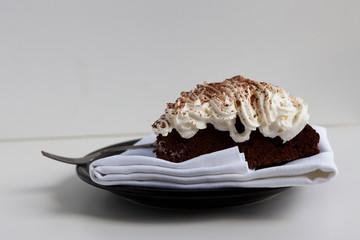 Piece of homemade chocolate cake with cream