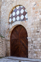 door in the tower of Alvar Fanez, Guadalajara, Spain