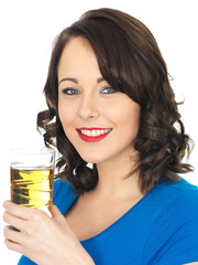 Attractive Young Woman Drinking Apple Juice